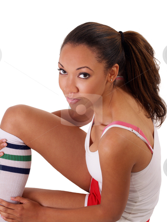 Young black woman in tank top and shorts stock photo, Young black woman sitting in white top and shorts by Jeff Cleveland