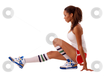 Young black woman stretching out in shorts stock photo, Young black woman in red shorts stretching out by Jeff Cleveland