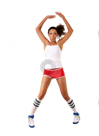 Young black woman jumping jack in shorts stock photo, Jumping jack blurred motion young black woman by Jeff Cleveland