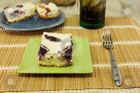 Blueberry cheesecake stock photo, Blueberry cheesecake with strawberry cheesecake in background by Lee Barnwell
