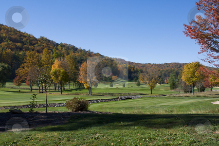 Mountain golfcourse at autumn stock photo, Colorful mountain view golfcourse at autumn by Lee Barnwell