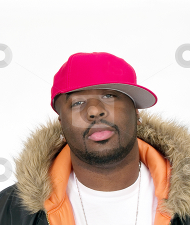 Young Black Man in Red Ball Cap stock photo, Young Black Man in Ball Cap and Jacket by Jeff Cleveland
