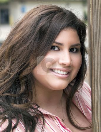 Portrati Plus-Size Hispanic Woman Outdoors Smiling stock photo, Outdoor portrait of smiling hispanic woman plus-size by Jeff Cleveland