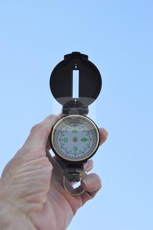 Lensatic Compass stock photo, A black lensatic compass and light blue sky by Lynn Bendickson