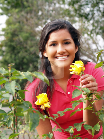 Young Hispanic Teen Girl with Yellow Roses stock photo, Young Hispanic Teen Girl Portrait with Yellow Rose by Jeff Cleveland