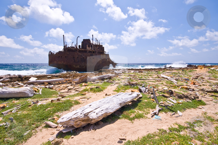 Rubbish rusty wreck stock photo, Rusty wreck on little curacao with rubbish washed on the shore line by Karin Claus