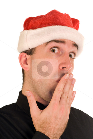 Tired Businessman stock photo, A closeup view of a businessman wearing a santa cap, looking tired by Richard Nelson