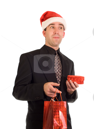 Corporate Xmas Gift stock photo, A young businessman holding a couple of Christmas gifts by Richard Nelson