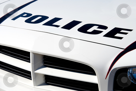 Police Car stock photo, The front end of a police car. by Robert Byron