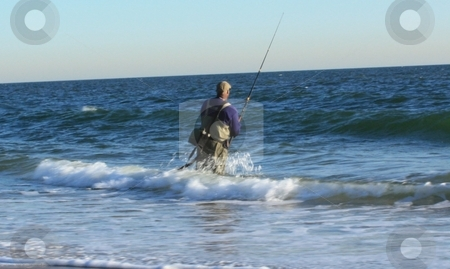 Surf Casting stock photo, Man fishing on beach by Linda Johnson