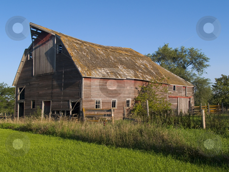 Summer Barn stock photo, A summer image of an old and rustic barn near Mitchell, South Dakota by John McLaird