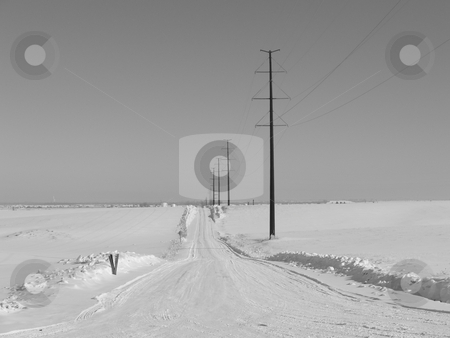 Empty Rural Winter Road stock photo, An empty rural winter road after a large snowstorm by John McLaird