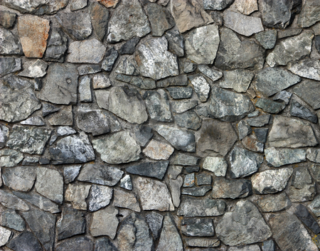 Rock Wall Background stock photo, Rock wall texture background. Rocks are an assortment of colours, shapes and sizes. by Julie Bentz