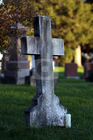 Not Forgotten stock photo, Closeup of a simple cross tombstone in an old cemetery. by Megan Lorenz