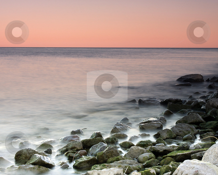 Tropical Hues stock photo, Beautiful sunset colors on Lake Ontario. by Megan Lorenz