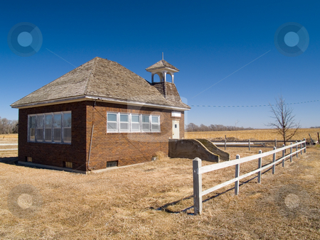 One Room School Under Blue Sky stock photo, An old one room school house on the vast Nebraska prairie by John McLaird