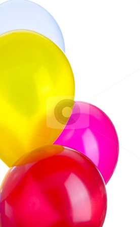 Four Balloons stock photo, Four balloons in a vertical image with copy space. by John McLaird