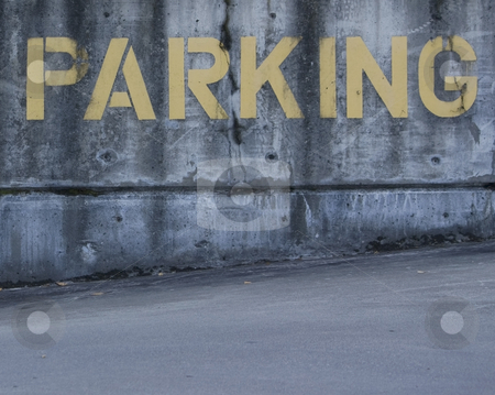 Yellow Parking Sign Painted on Cement stock photo, Parking sign painted on cement in yellow. by Julie Bentz