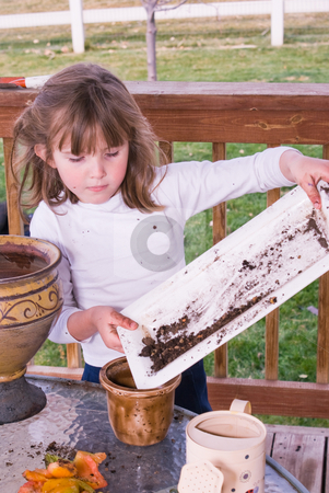 Just a little more dirt stock photo, Little girl playing with gardening pots by RCarner Photography
