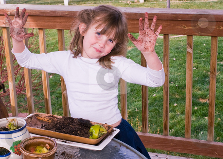 Not very dirty stock photo, Little girl playing with gardening dirt by RCarner Photography