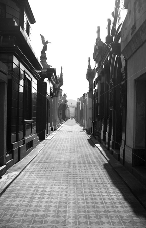 Cementerio de la Recoleta - Recoleta Cemetery stock photo, View down a row of graves inside the famous above-ground cemetery of Recoleta in central Buenos Aires Argentina by Lee Torrens