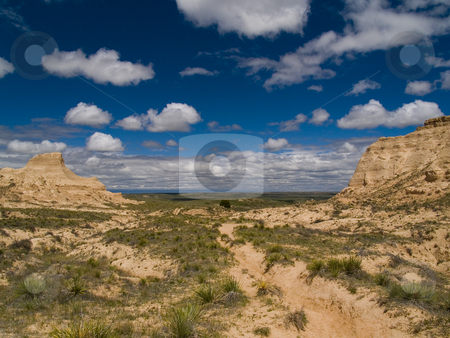 Bluffs framing Blue Sky stock photo, Near Pawnee Buttes on the plains of Colorado. by John McLaird