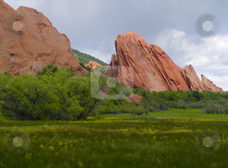 Red Rocks in Bloom stock photo, Red rocks and a blooming meadow as spring covers Roxborough State Park,  Colorado by John McLaird