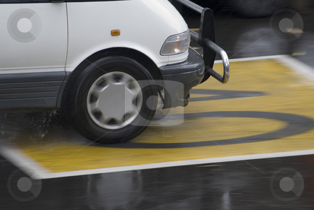 Wet roads stock photo, Driving on a wet road through a 40 zone by Stephen Gibson