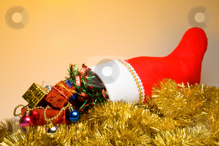 Christmas Stocking stock photo, A Christmas stocking filled with holiday goodies. by Robert Byron