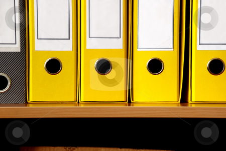 Yellow files stock photo, Yellow pasteboard files in row close up crop by Julija Sapic