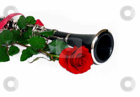 Red rose clarinet stock photo, Beautiful red rose and clarinet composition over white by Julija Sapic