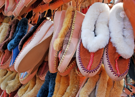 Slippers stock photo, Various comfortable home shoes keeping warm hanging by Julija Sapic