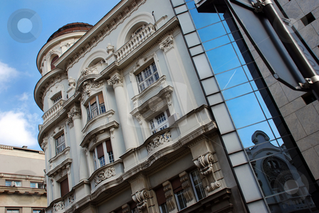 Belgrade architecture stock photo, Building in center of Belgrade, Serbia, plane in window reflection by Julija Sapic