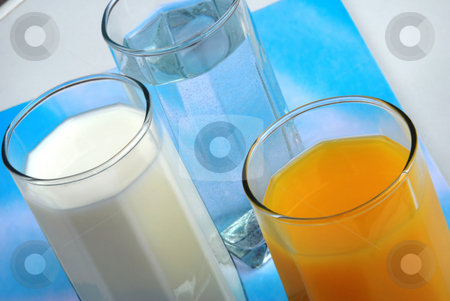 Healthy drink stock photo, Three glasses with water, milk and juice closeup by Julija Sapic