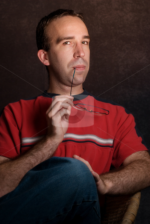 Sophisticated Male stock photo, A young sophisticated looking male wearing casual clothing by Richard Nelson