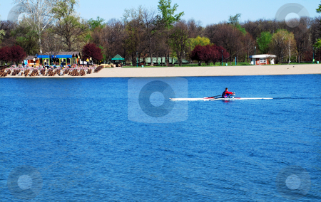Kayak over  blue water stock photo, Sole kayak over blue water at sunny spring morning by Julija Sapic