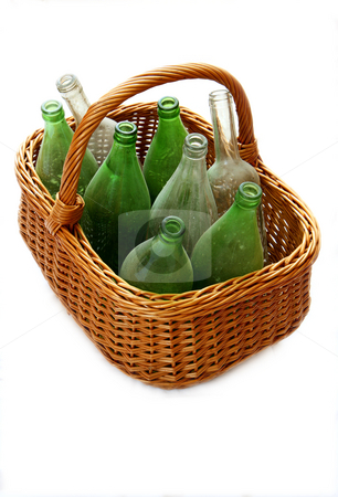 Bottles and Basket stock photo, Dusty wine bottles waiting for cleaning. by Gyozo Toth