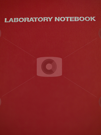 Laboratory notebook stock photo, Red leather laboratory notebook with copyspace by Laurent Dambies