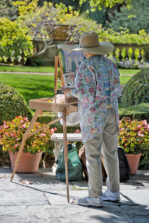 Painting Artist stock photo, Artist painting a picture in a garden on a sunny day by Denis Radovanovic