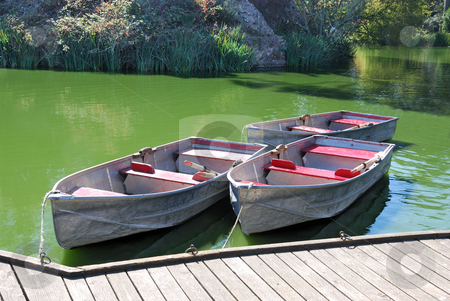 Three Boats on Lake stock photo, Three boats docked on a lake on a sunny day by Denis Radovanovic