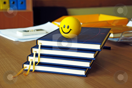 New plans stock photo, New blue organizers and yellow smiley ball on office desk by Julija Sapic