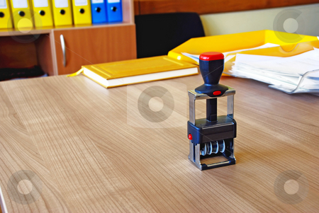 Office stamp stock photo, Black stamp on wooden desk in office over files background by Julija Sapic