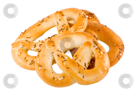 Pretzels stock photo, A pile of salty crunchy pretzel on the white background by Petr Koudelka