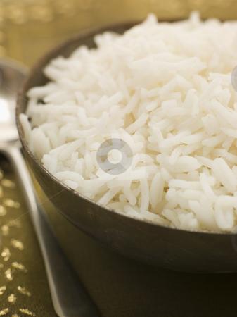 Bowl of Plain Boiled Basmati Rice stock photo, Bowl of Plain Boiled Basmati Rice with serving spoon by Monkey Business Images
