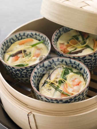 Steamed savoury Custards in a Steamer stock photo, 3 dishes of Steamed savoury Custards in a bamboo Steamer by Monkey Business Images