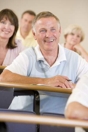 Senior man listening to a university lecture stock photo,  by Monkey Business Images
