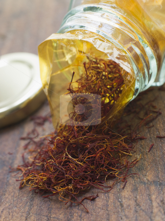 Jar of Kashmir Saffron Strands stock photo, Close up of Jar of Kashmir Saffron Strands by Monkey Business Images