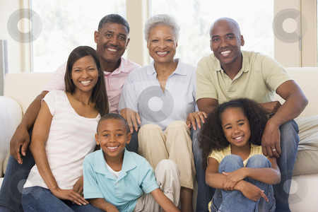 Extended family in living room smiling stock photo,  by Monkey Business Images