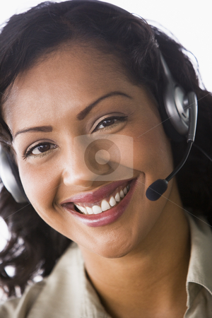 Female telesales worker stock photo, Close-up of telesales worker by Monkey Business Images