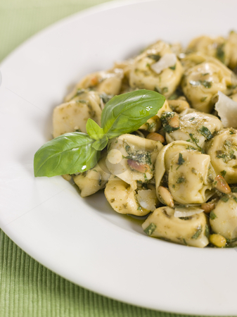 Chicken and Mushroom Tortelinni with Pesto and Pine Nuts stock photo,  by Monkey Business Images